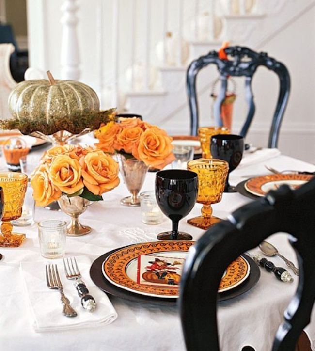 Romantic-Halloween-table-setting-with-orange-roses